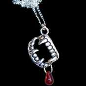 Love Bite Me Fang Banger True Blood Drop VAMPIRE FANGS FALSE TEETH PENDANT NECKLACE Gothic Undead Teeth Charm Costume Jewelry. Halloween Dracula Charm Amulet. Fun accessory for True Blood, Vampire Diaries, Twilight party Edward or Jacob fans.