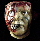 Walking Dead Bloody ZOMBIE CANDY BOWL TREAT BUCKET. Life Size Creepy Bleeding Severed Head Serving Dish looks like it came straight out of a horror movie. A terrifying table centerpiece, Halloween decoration or horror prop for a mad scientist lab!