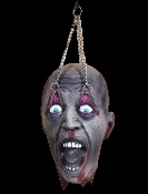 Life size realistic hanging dead decapitated severed cut off head hangs from chained eye lids. EYELID KID Horror movie Halloween prop haunted house decoration. Gory disturbing Walking Dead, dungeon torture, butcher chop shop, theater prop decor.