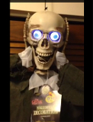 Life Size Hanging ANIMATED HEAD DETACHED SKELETON Gothic Creepy Halloween Prop Decoration - LED Light up eyes flash as he says several creepy Halloween haunt phrases in a spooky voice. ''There's something spooky out tonight, and I think it's you!''