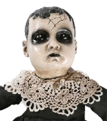 Creepy realistic haunted doll with sound has a spooky face, black eyes, fake cracks for a ghostly look. Scary toy monster talking dolly. Spooktacular gothic Halloween haunted house prop decoration. Innocent childlike voice speaks with nursery music.