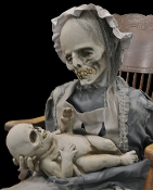 Deluxe Latex LULLABY ANIMATED PROP Creepy Gothic Horror Halloween Decoration - Ghostly mom and child rocks back and forth singing softly. Unnerving! Soundtrack CD is included. You provide chair and CD player. All electric! Clothing may vary.