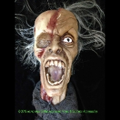 Realistic Life Size Severed Cut-Off HANGING SCREAMING SHRUNKEN ZOMBIE HUMAN HEAD Halloween Horror Prop - Full size PVC, open mouth head, flesh torn away revealing skull bone. Hair and ragged cloth attached. Top of head to bottom of cloth 29-inches.