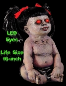 Scary Life Size DEMONICA UNDEAD BABY DOLL Possessed Monster Girl Halloween Prop Decoration. Creepy glowing blood red eyes, MOTION ACTIVATED GROWLING CRYING SOUNDS, cute pigtails, devilish fangs. Latex Evil Hell Spawn Tot has spooky LED eyes. 16-inch.