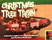 ANIMATED CHRISTMAS TREE TRAIN SET is a moving, light and sound enhanced holiday decoration. MOUNTS IN TREE! Light up train engine car flashing headlight, realistic engine choo-choo sounds, ding-ding bell, ALL ABOARD announcement. Over 8-ft of track!
